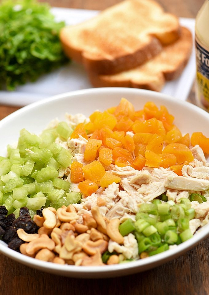 Shredded chicken, dried apricots, cashews, celery, raisins, and green onions are the perfect combination for this chicken salad.