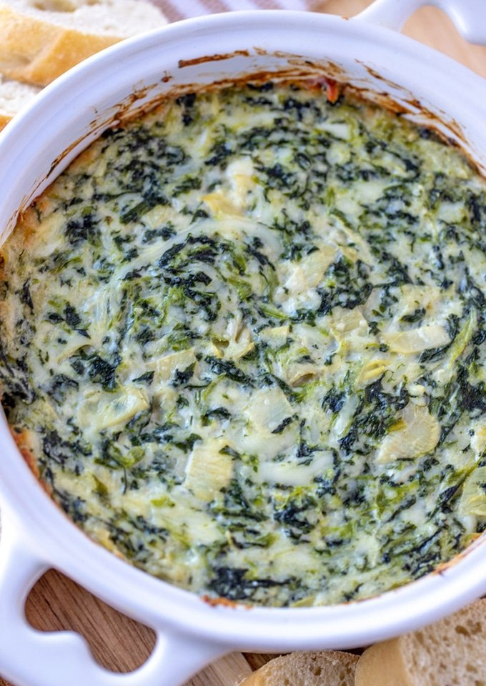 Spinach Artichoke dip in a white baking dish