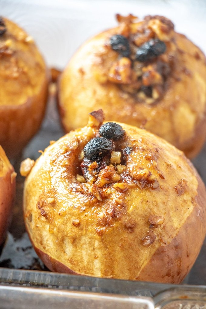 Baked Apples stuffed with raisins, walnuts, and brown sugar streusel are delicious on their own or topped with ice cream. Perfectly sweet and cinnamon-y, they're the ultimate Fall treat.