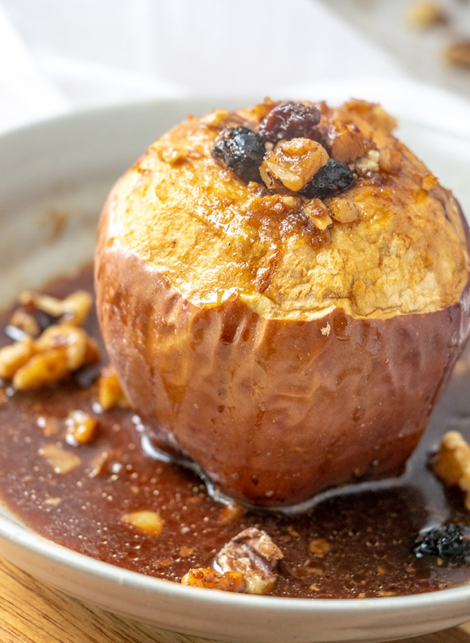 Baked Cinnamon Apples with raisins and walnuts and poached in green tea are the ultimate Fall treat. Serve warm on they're on or topped with ice cream for the perfect after-dinner dessert.