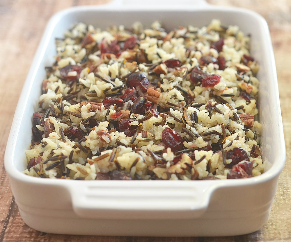 Cranberry Wild Rice Stuffing Casserole baked in the oven is easy to make with simple ingredients. Perfect as a side dish or as stuffing.