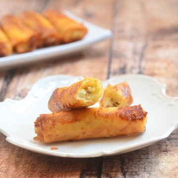 Banana and Cream Cheese Spring Rolls made of banana and cream cheese wrapped in spring roll wrappers and fried until golden crisp. So addictingly delicious, you'll be hard pressed to eat just one!