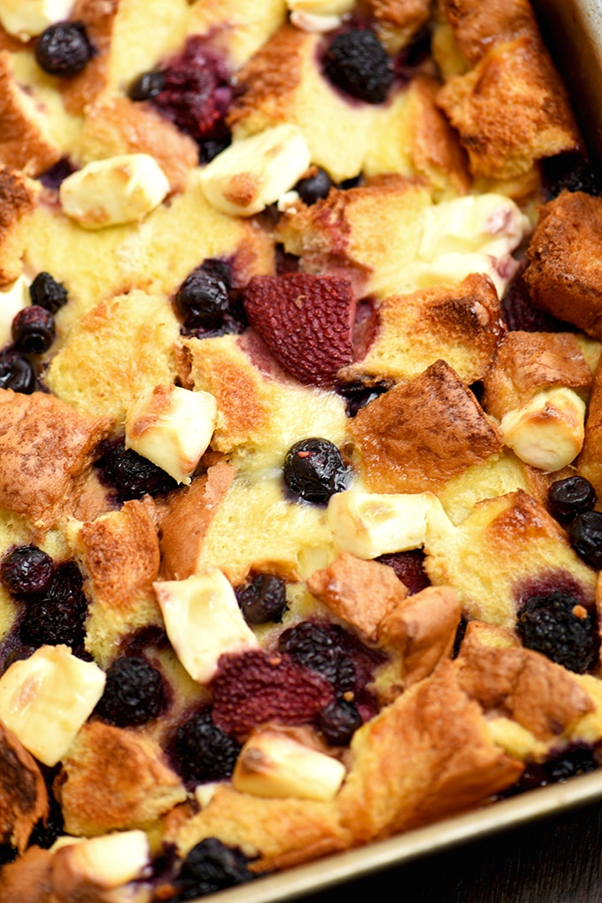 Berry French Toast Bake with cream cheese and fruit sauce for the perfect breakfast or brunch!