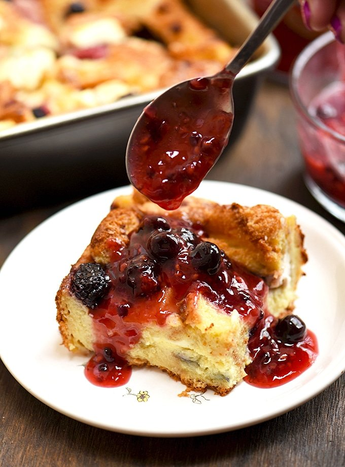 Mixed Berry French Toast Bake with berries, cream cheese and fruit sauce topping. So easy to make and so delicious!