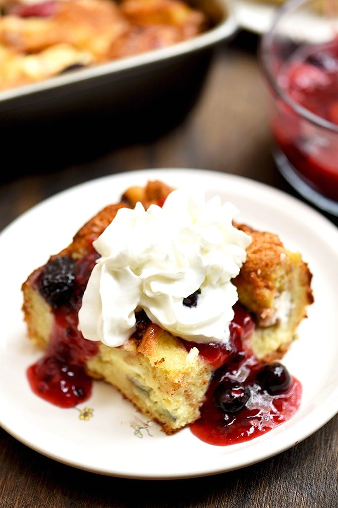 French Toast bake with cream cheese, blueberries, strawberries, raspberries, and blackberries. Topped with fruit sauce and whipped topping!