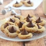 Peanut Butter Blossoms made of chewy peanut butter cookies and sweet chocolate kiss centers. These are as fun to make as they are to eat!