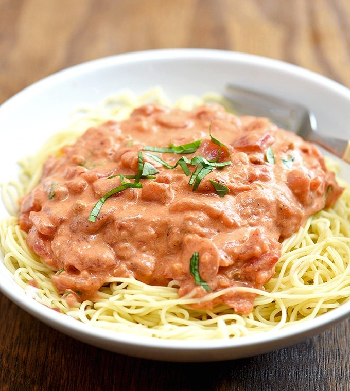 Angel Hair Pasta with Tomato Cream Sauce on a white plate
