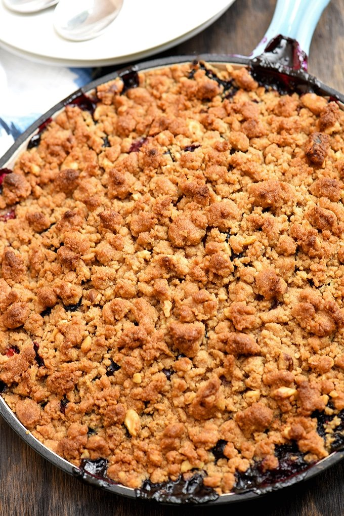 Top view of berry crumble baked in blue skillet