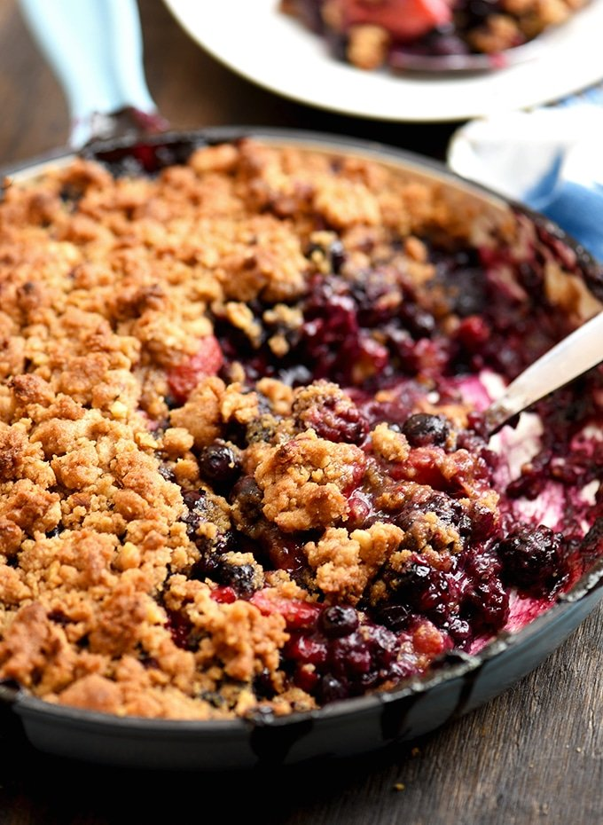 Mixed Berry Crumble baked in a blue enameled cast iron skillet