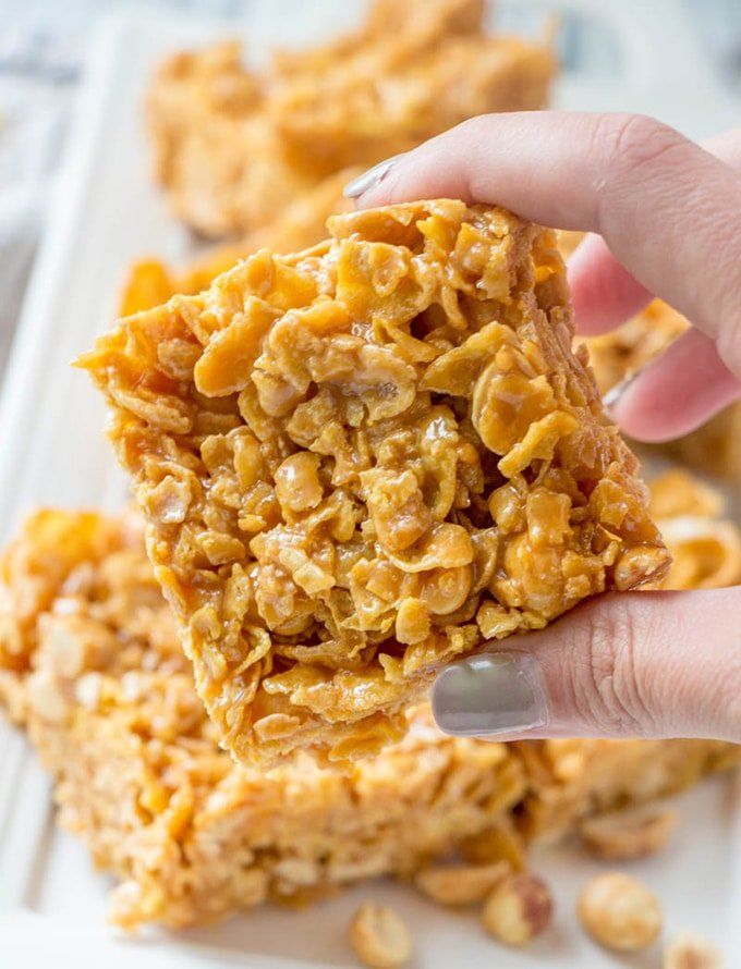 Peanut Cereal Caramel Square with an addicting combo of sweet and salty flavors! Chewy and gooey, these caramel squares are the perfect snack and make great gifts, too!