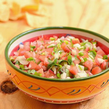 Homemade Pico de Gallo with fresh flavors from tomatoes, onions, jalapenos, and lime juice. This salsa fresca is amazing as a dip as well as condiment for your favorite food. Easily turn it into guacamole with a few avocados!