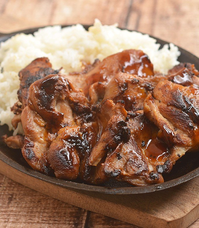 Sweet Mango Barbecue Chicken with a sweet and tangy marinade that's out of this world! Juicy, flavorful, and with a tropical twist, it's a must for your summer BBQ's!