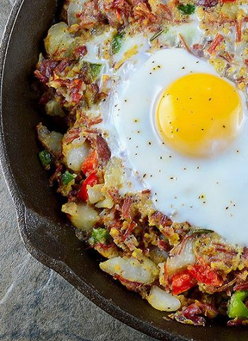 Corned Beef Hash is a delicious breakfast you can whip up from your leftover St. Patrick's feast! A hearty combination of corned beef, potatoes, bell peppers, and runny eggs, it makes a great dinner, too!