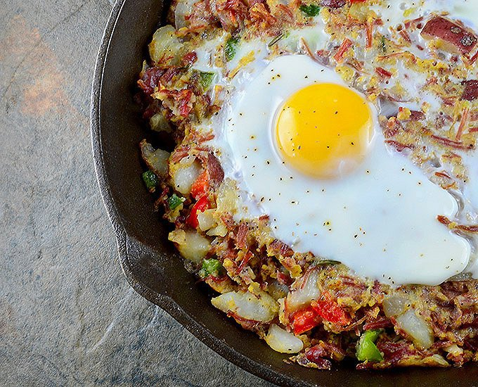 Corned Beef Hash is a delicious breakfast you can whip up from your leftover St. Patrick's feast! A hearty combination of corned beef, potatoes, bell peppers, and soft yolks, it makes a great dinner, too!