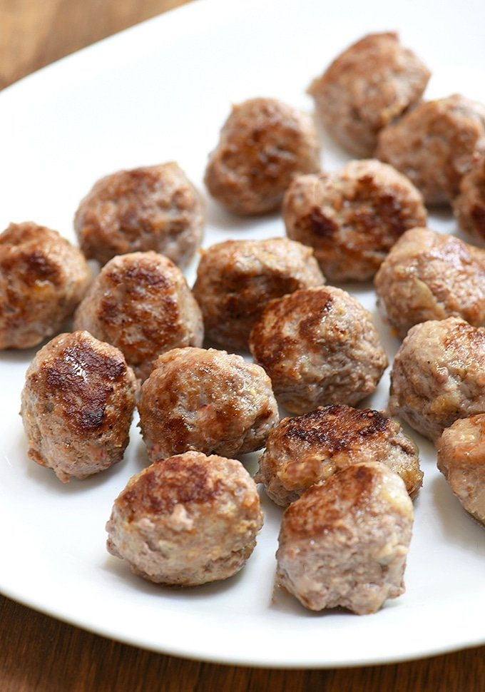 pan-fried meatballs on a white platter