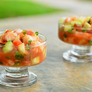 Coctel de Camarones with shrimp, tomatoes, onions, cucumber, cilantro, jalapenos in clam and tomato juice cocktail. This refreshing Mexican shrimp cocktail is best served with saltine crackers or tostadas.