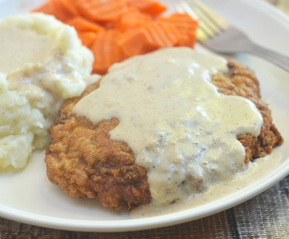Country Fried Steak with Creamy Gravy made crispy, super tender and tasty using a buttermilk marinade. Hearty and delicious with a flavorful milk gravy, it is the ultimate comfort food.