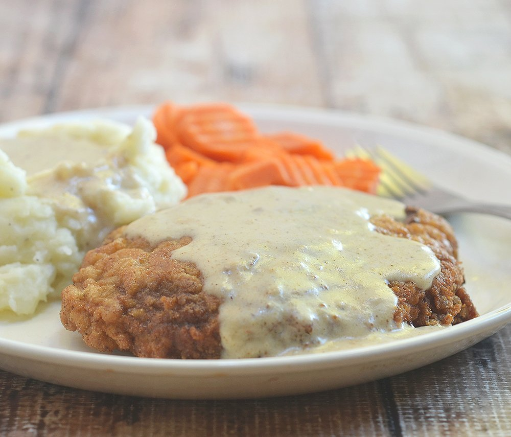 Chicken Fried Steak with cream gravy is crispy, super tender, and the perfect breakfast, lunch or dinner meal!