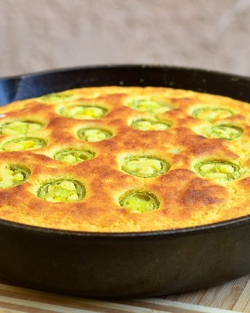 Jalapeno skillet cornbread generously studded with jalapenos. Soft, moist with a kick of spice, it's the perfect pair for hearty bowls of chili or stew!