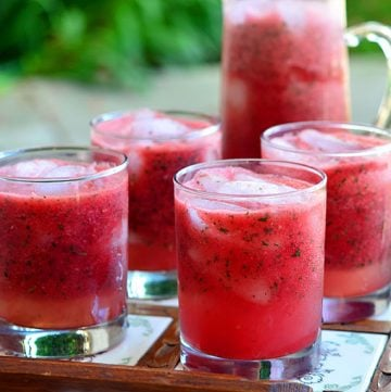 Minty Watermelon Cooler made with fresh watermelon, lime juice, and mint is a delicious way to beat the heat! A few splashes of vodka or rum easily turn it into a grown-up cocktail!