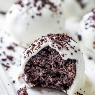 Oreo Truffle Balls with white chocolate coating and cookie crumbs on a serving platter