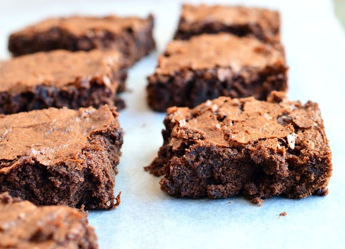 John Elway's Chocolate Brownies are thick, fudgy, chewy, and chocolatey with a delicious hint of coffee and a crackly top. Quick, easy, and so yummy, you'll never make brownies from a box mix again!