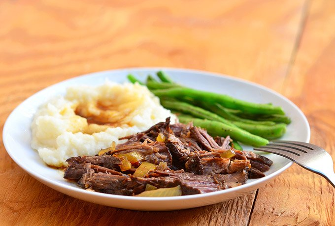 Slow Cooker Cola Roast with sweet, spicy flavors and moist, tender meat. Cooked in the crockpot, it's a hands-off meal for easy weeknight dinners.