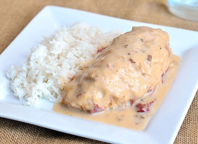 Slow Cooker Mushroom Chicken wrapped in bacon and cooked in the crockpot with cream of mushroom and chipped beef. Perfect with rice, noodles or mashed potatoes.