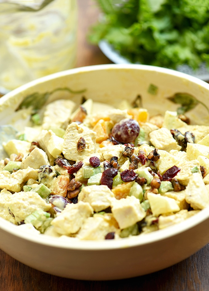chicken salad with apples, grapes, dried fruit, and candied nuts in curry mayo dressing