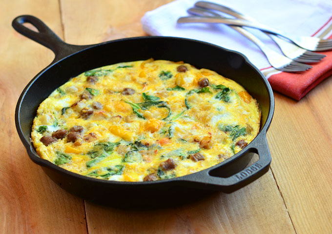 Frittata made of potatoes, sausage, spinach, sweet peppers, and cheese ...