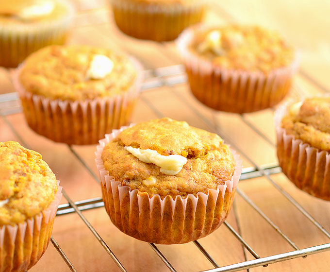 Pumpkin Cream Cheese Muffins filled with creamy cream cheese and apricot preserves. Bursting with Fall flavors, they're amazing for breakfast or anytime you need a sweet treat!