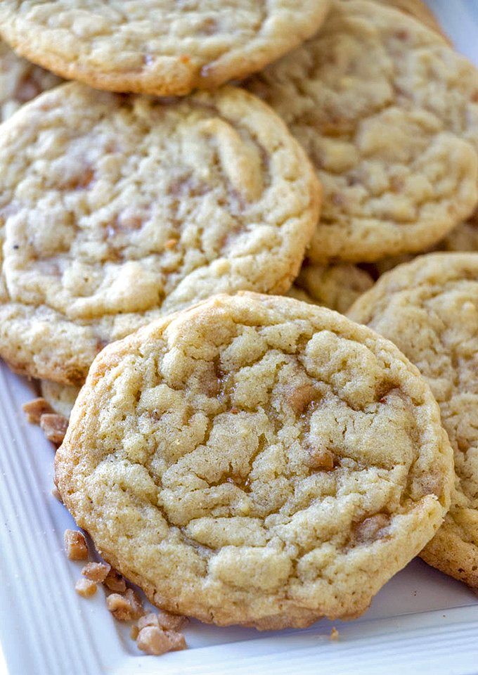 These heath toffee cookies look irresistible on this white plate, ready for serving.