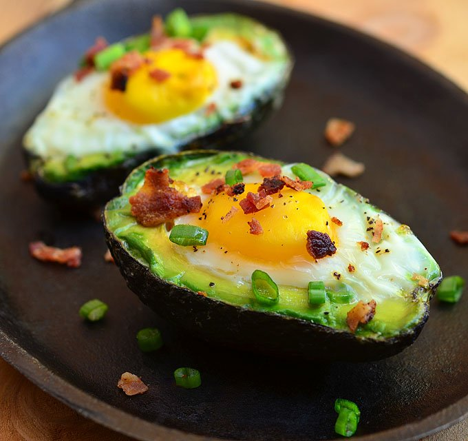 Avocado Egg Cups with runny yolks, crisp bacon, and green onions nestled in creamy avocados. They are a simple yet satisfying breakfast treat everyone would love waking up for!