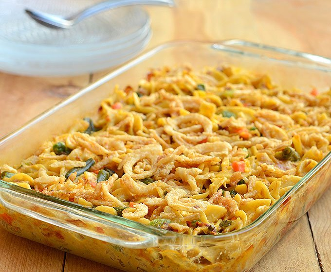 Easy-Cheesy Tuna Noodle Casserole is the best tuna casserole ever! Loaded with mixed vegetables, creamy sauce, and crispy french-fried onions, it's pure comfort food.