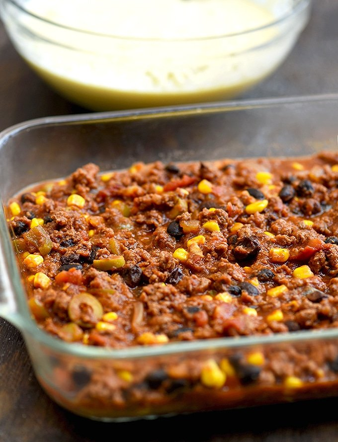Beef Tamale Pie with a savory ground beef, corn, black beans, and olives filling.