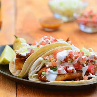 Blackened tilapia fish tacos seasoned with an amazing spice rub and topped with shredded cabbage, fresh pico de gallo, and crema Mexicana. They're a fresh, healthy, and easy meal for busy weeknights!