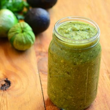 Avocado Tomatillo Salsa is about to become your top choice for condiment! Made with tomatillos, chili peppers, and avocado, it's amazing over tacos, breakfast eggs or any of your favorite foods for a delicious kick of flavor!