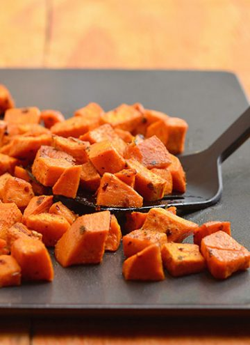 Roasted spiced sweet potatoes seasoned with spices and roasted until golden and crisp are the perfect Fall side dish. The perfect pair for any roasted meat, they're sure to be the star of your Thanksgiving festivities!