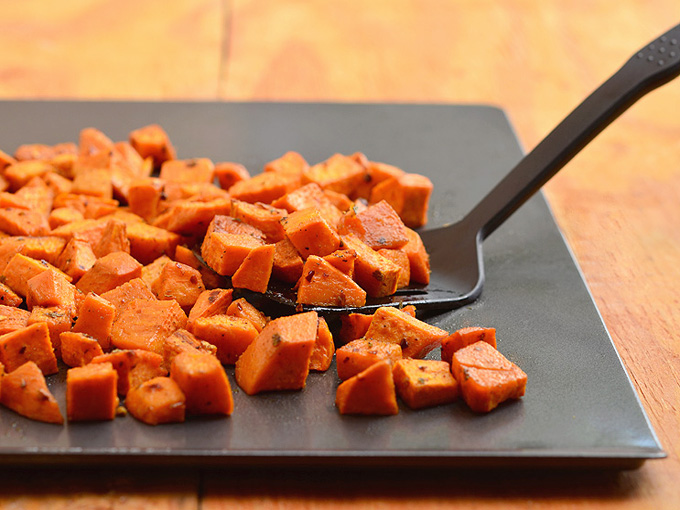 Roasted spiced sweet potatoes seasoned with spices and roasted until golden and crisp are the perfect Fall side dish. Amazing with any roasted meat, they're sure to be the star of your Thanksgiving festivities!