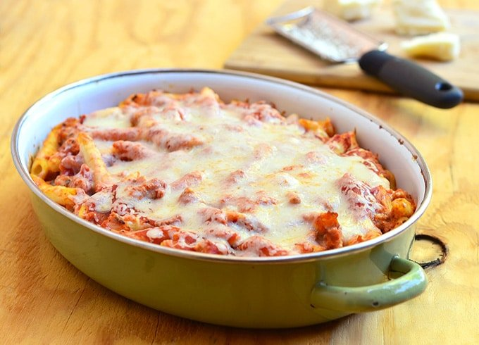 baked ziti with ricotta and Italian sausage in a casserole dish