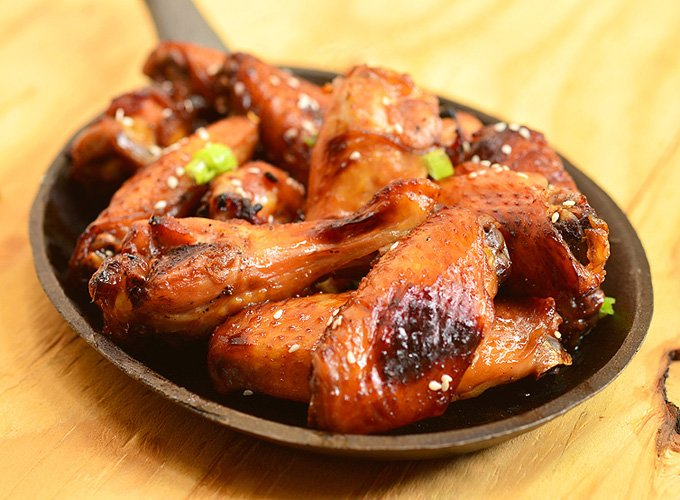 Honey Soy Chicken Wings are so easy to make and perfect for game day.  Marinated in soy sauce, honey, orange juice, and garlic mixture, they're sweet, salty, sticky, and finger-licking delicious!