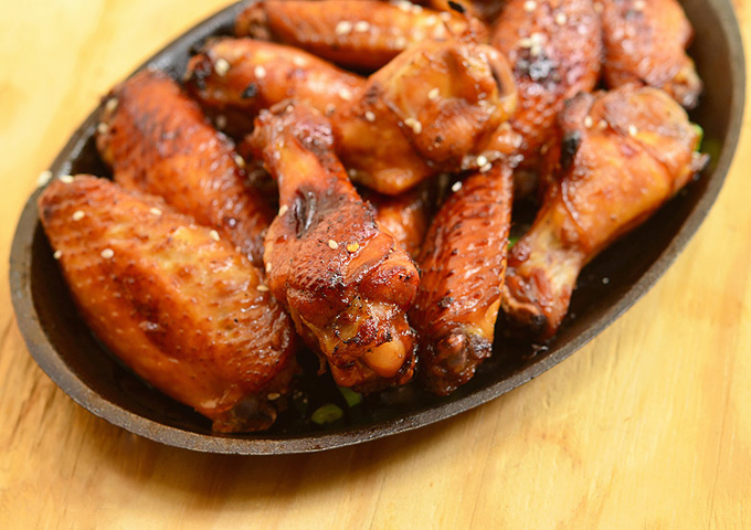 Honey Soy Sauce Chicken Wings baked in the oven for an easy game day appetizer. They're sweet, savory, sticky and absolutely yummy!
