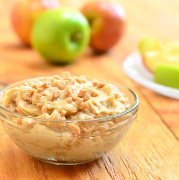Candy Crunch dip loaded with toffee bits is a delicious dessert dip you'd love digging into with apples, graham crackers, and vanilla wafers! So addicting, you might as well call it candy CRACK dip!