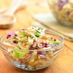 Peanut coleslaw with cabbage, carrots, celery, green onions, and crunchy peanuts dressed in a tangy vinaigrette dressing. A delicious Wood Ranch BBQ and Grill copycat recipe, it's sure to wow the crowd!