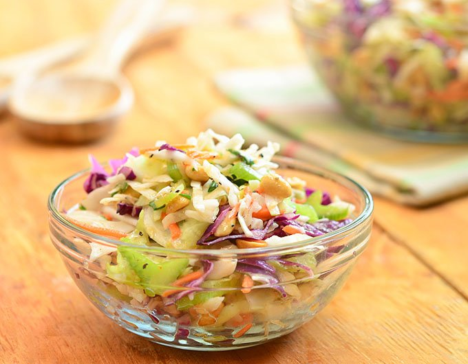 Peanut coleslaw with cabbage, carrots, celery, green onions, and crunchy peanuts dressed in a tangy vinaigrette dressing. A delicious Wood Ranch restaurant copycat recipe, it's sure to wow the crowd!