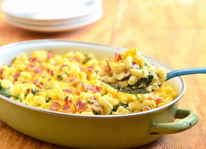 Baked Macaroni and Cheese hot and fresh from the oven. Loaded with bacon and spinach, it's the ultimate comfort food.