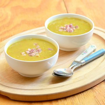 Split Pea and Ham Soup made extra tasty with ham bone, carrots, and, celery, and onions is the perfect comfort food. Thick, hearty, and flavorful, it's nutritious as its delicious!