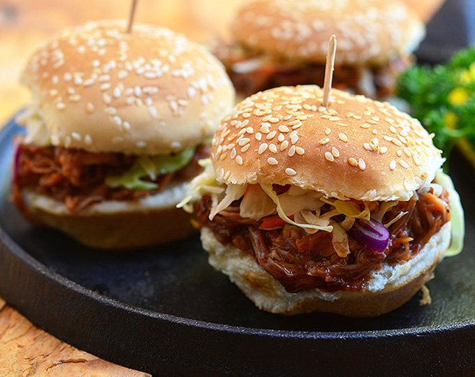 These sliders have it all: slow cooker root beer pulled pork, crisp homemade coleslaw, and fun-size buns!