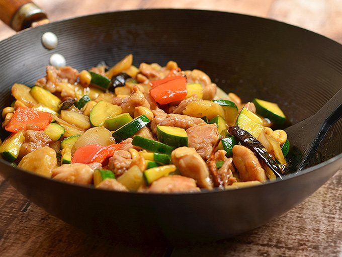 Easy Kung Pao Chicken Recipe with moist chicken, crisp zucchini, crunchy water chestnuts and peanuts, and vibrant peppers in a sweet and savory sauce. All the bold flavors of your favorite restaurant takeout cooked in one pan and in under 30 minutes!