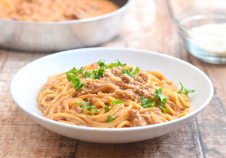 Cheesy Spaghetti with creamy tomato sauce is quick and easy to make for busy weeknights and with loads of delicious cheesy flavor the whole family is sure to love.